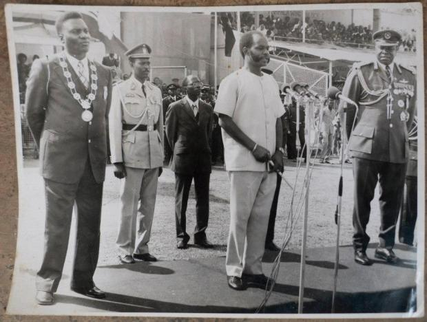 H.E. President Lt. Gen. M. Micombero addresses the Public in Nakivubo Stadium on the 3rd Anniversary of the Second Republic. On his left is H.E. President Gen. Idi Amin of Uganda and on his right is H.E. Maj. Gen. Habyalimana president of Ruanda