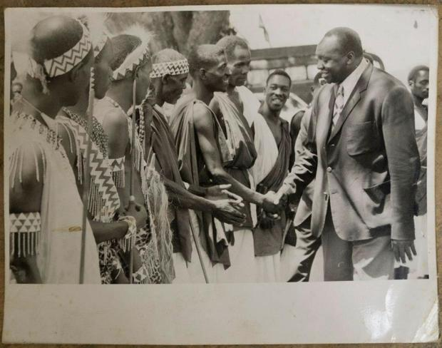 H.E. President Gen. Idi Amin shakes hands with dancers from Rwandese Republic