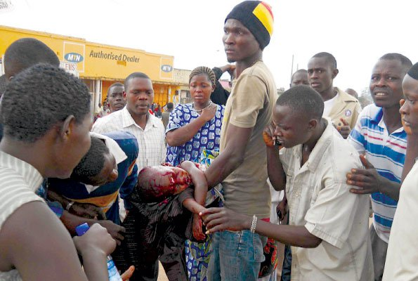 A child shot by the police during the riots in Masaka . She died 2 hours later