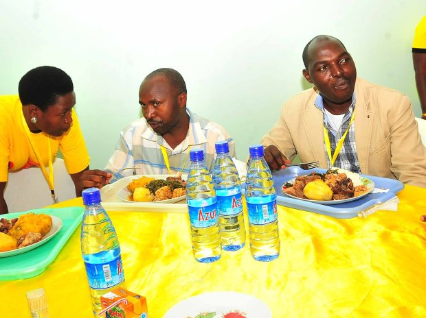 MPs Theodore Ssekikuubo and Tinkasimire having luch at the NRM retreat in Kyankwanzi contray to media reports that the MPs vowed to boycot the food and that they would survive on biscuits