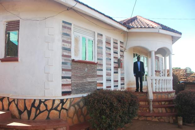 Kirunda at his house. kirunda is a Media Management Officer at state house uganda