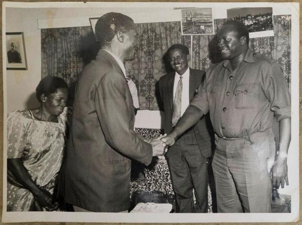 Minister Byagagaire on Amin's right hand side