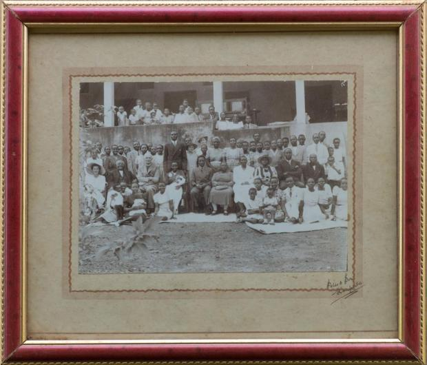 The Ham Mukasa's and the Mulyanti's family. The photo well could be in de 1930's or even before,co'z u see de kabaka Mutesa en to de left is Mr.Ham Mukasa Sekibobo.This picture was taken in Mengo- Kewerimidde house in the back yard. I am almost sure about that