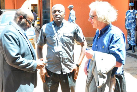 Monitor Executive Editor Simon Freeman (R), News Editor Alex Atuhaire (C), and Managing Editor Don Wanyama