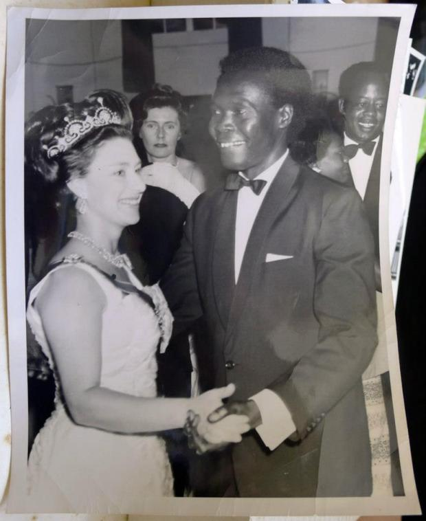 That white beauty dancing with Obote is actually the late Princess Margaret, the younger sister of Queen Elizabeth II of the United Kingdom.