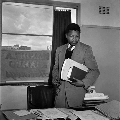 Nelson Mandela at his law offices (shared with Oliver Tambo) in Johannesburg sometime in the late 1950's.