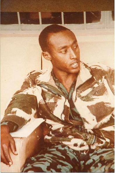 """Maj. Dr. Peter Bayingana: this picture means """"sacrifice"""", """"patriotism"""" and """"heroism"""", I believe. Dr Bayingana was young, intelligent, caring, combatant and a true revolutionary. He had a good job in Nairobi left everything and joined NRA in the name of the love he had for his country and his people. Through NRA was the only to way to able him to fight and save his country. He was a fighter and life saving as a Doctor. What breaks my heart is thinking of where we would be if. the lives of these young intelligent, combatant and true revolutionaries Folks were not taken away from us. God loves the best ones . He once worked at Republic House in Uganda. Dr. Major Bayingana you shall be always remembered. RIP"""
