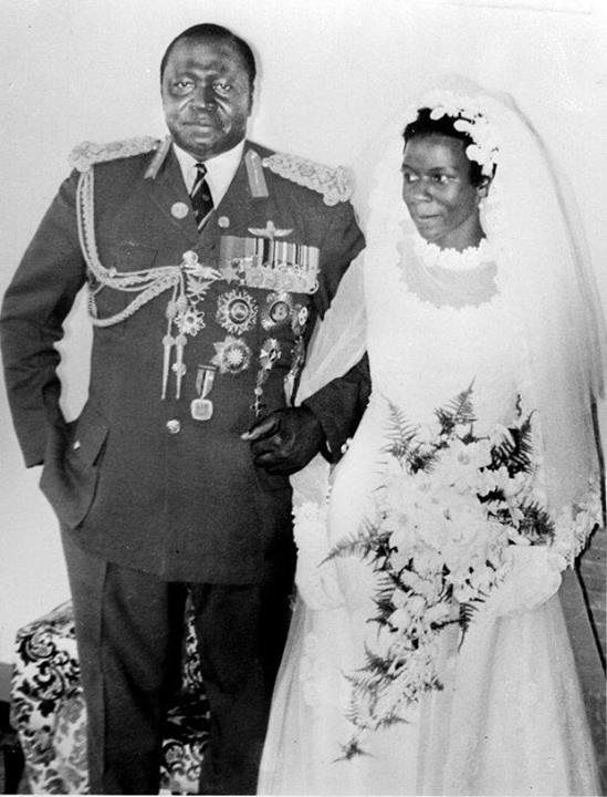 President of Uganda Idi Amin Dada poses with his new bride Sarah Kyolaba after their wedding in August1975 at Shimoni Nile Mansions Nakasero Kampala Uganda