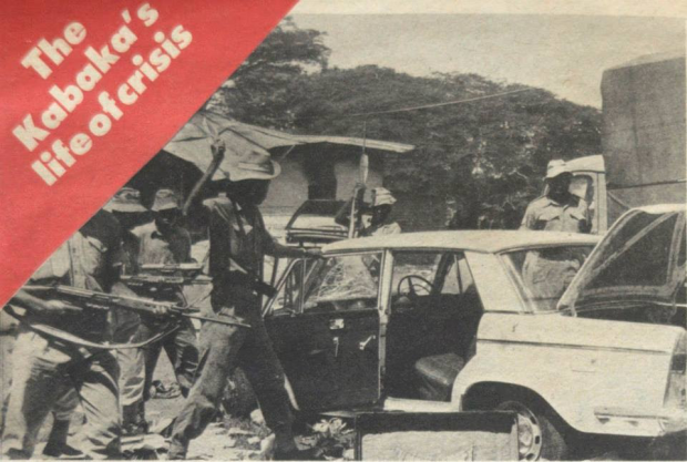 'Troops search a car outside kabaka's palace in Kampala afer Milton Obote, Uganda's Prime Minister, had ousted the Kabaka as President and sent the Army to arrest hom. But the Kabaka's guard fought stubbornly, enabling their monarch to flee the country.'